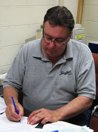 President Scott Sharp of Racine clc signs a letter to sheridan